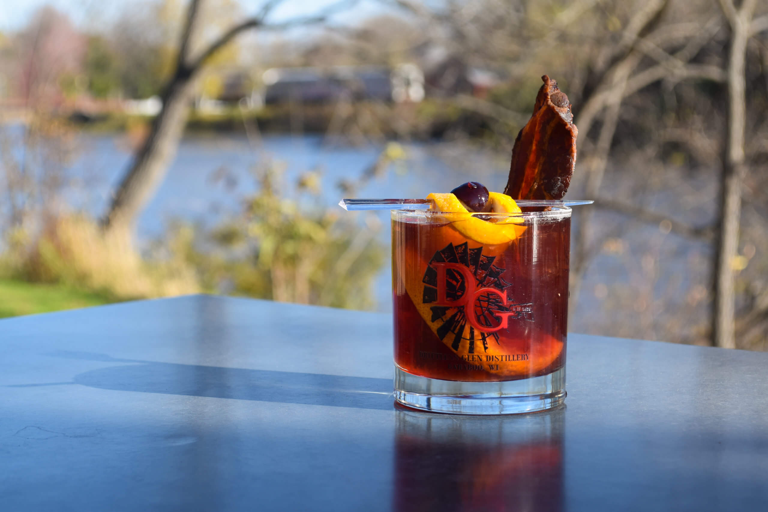 Old Fashioned cocktail by the river